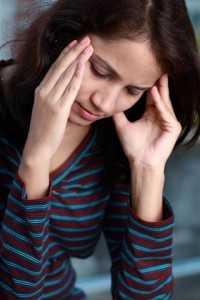 http://www.dreamstime.com/royalty-free-stock-images-young-woman-headache-image23221249